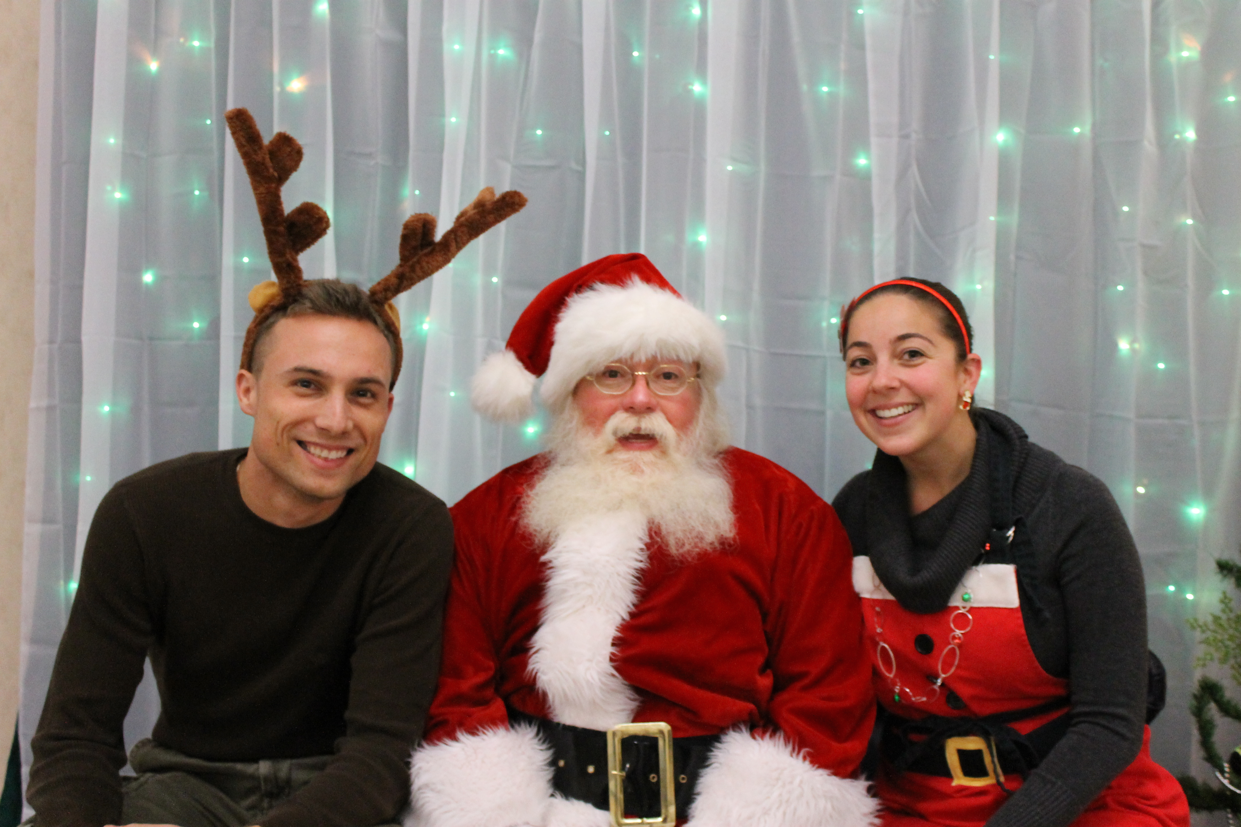 Photo of Santa and a man and woman
