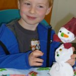 Photo of boy with snowman craft