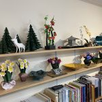 The image is of Rich Gray's studio. The image shows origami flowers, animals, and books.