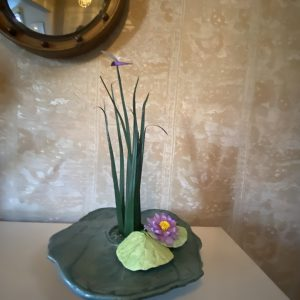 The image is of paper and ceramic art.